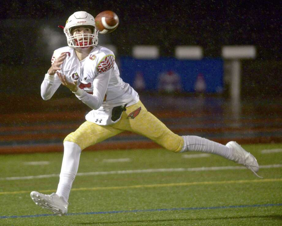 Greenwich's Garrett Murphy was all alone in the end zone for a touchdown pass from quarterback Gavin Muir against Danbury on Friday in Danbury. Photo: H John Voorhees III / Hearst Connecticut Media / The News-Times