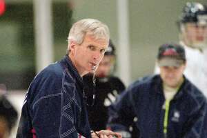 Yale hockey coach Tim Taylor watches his team during practice at the Ingalls Rink in New Haven in 1998.
