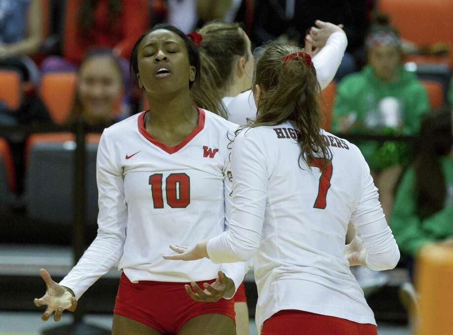 The Woodlands middle blocker Amanda Ifeanyi (10) reacts to a double contact call against the Highlanders during the third set of a Region II semifinal match at Johnson Coliseum, Friday, Nov. 9, 2018, in Huntsville. Photo: Jason Fochtman, Houston Chronicle / Staff Photographer / © 2018 Houston Chronicle