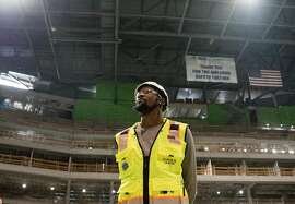 Warriors Kevin Durant looks up while standing in the middle of the future site of the main arena inside the Chase Center while under construction along the waterfront near the Mission Bay neighborhood of San Francisco, Calif. Friday, Nov. 9, 2018.