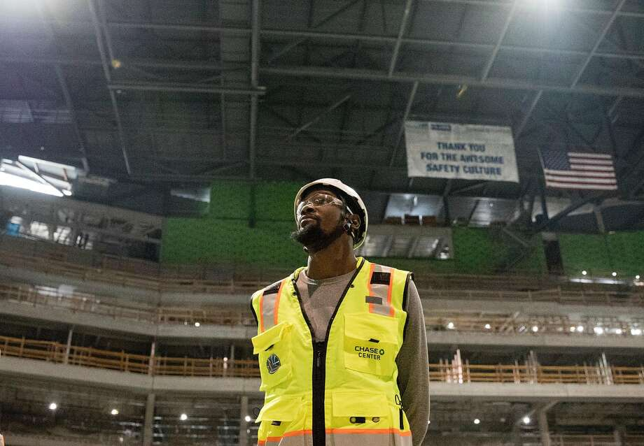 Warriors Kevin Durant looks up while standing in the middle of the future site of the main arena inside the Chase Center while under construction along the waterfront near the Mission Bay neighborhood of San Francisco, Calif. Friday, Nov. 9, 2018. Photo: Jessica Christian / The Chronicle