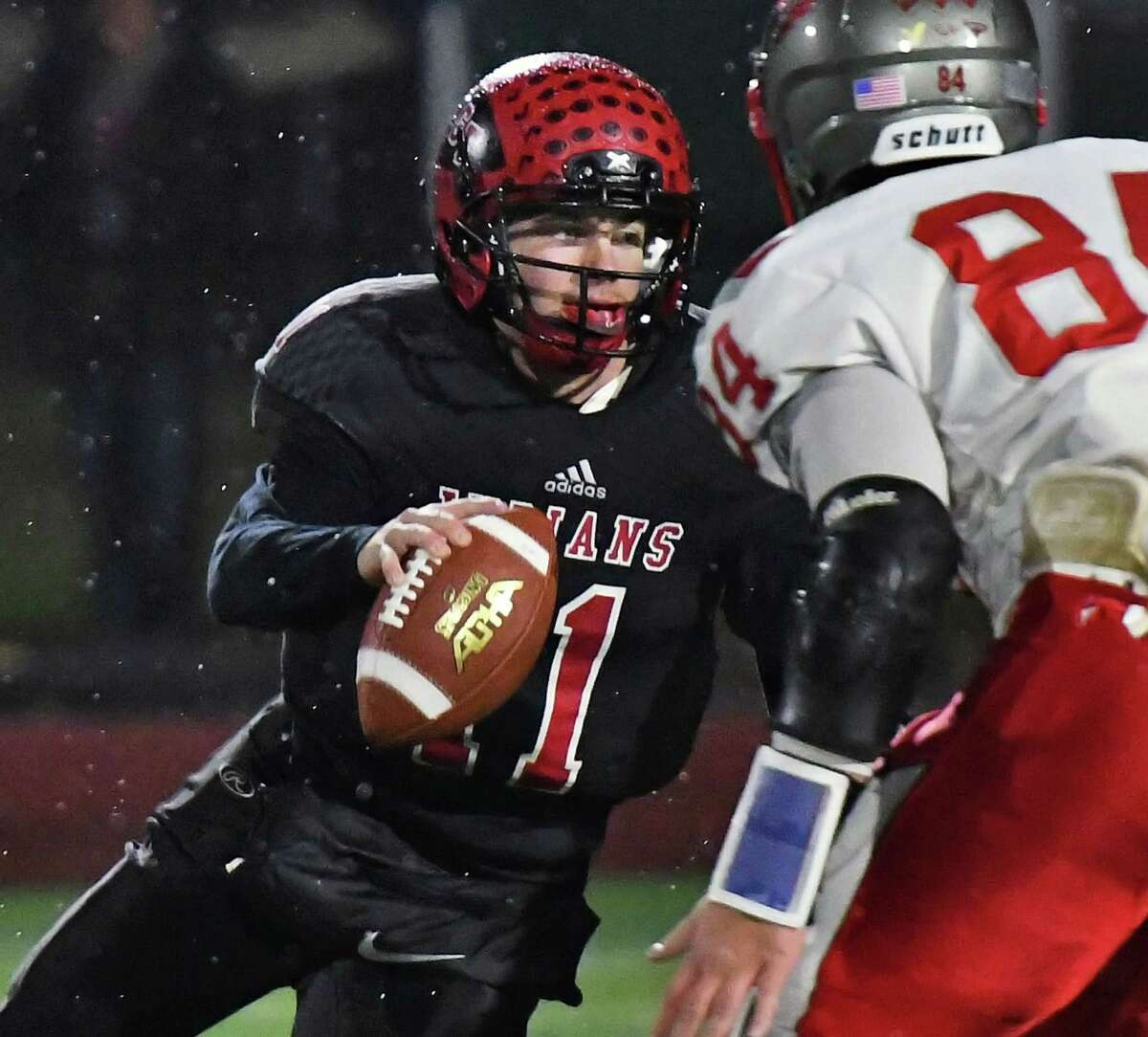 Glens Falls' QB Joseph Girard III scrambles before getting off a pass during their game against Beekmantown Friday Nov. 9, 2018 in Clifton Park, NY. (John Carl D'Annibale/Times Union)