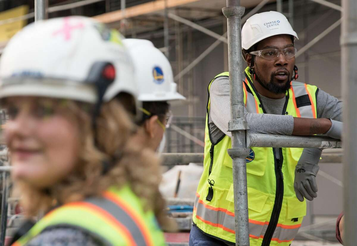 Warriors' Kevin Durant joins a tour of the Chase Center under construction along the waterfront near the Mission Bay neighborhood of San Francisco, Calif. Friday, Nov. 9, 2018.