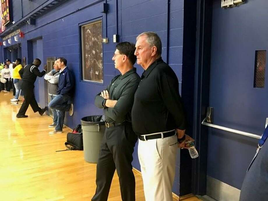 Jim Calhoun, right, and former UConn and current University of Saint Joseph assistant Glen Miller prior to Friday night's game. Photo: David Borges / New Haven Register