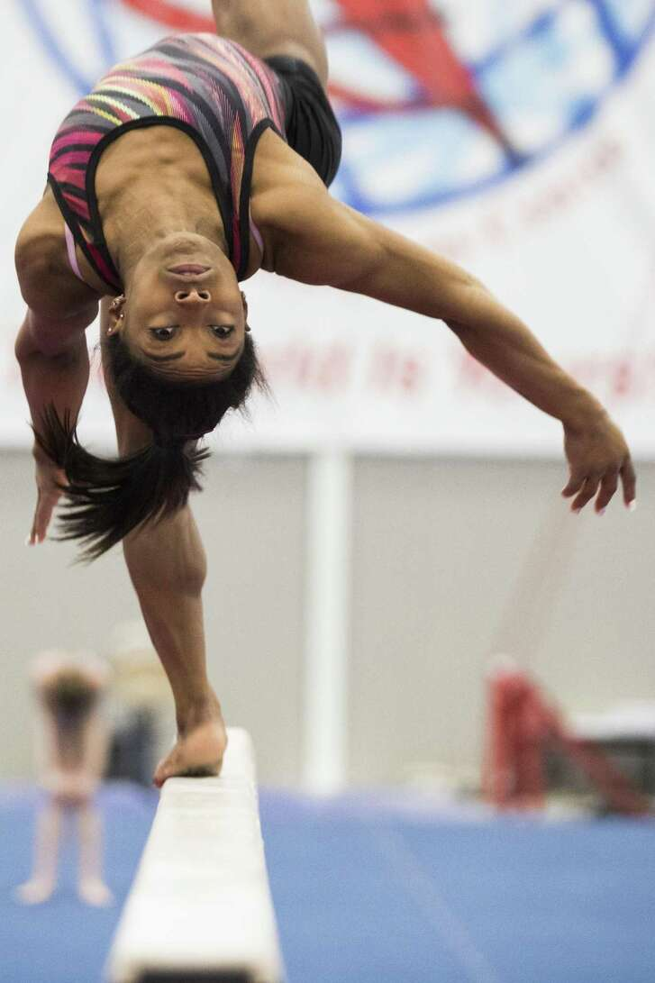 Fresh from picking up six medals — four gold — at the world championships in Doha, Qatar, gymnast Simone Biles is back in Spring working on her balance beam routine Friday at the World Champions Centre.