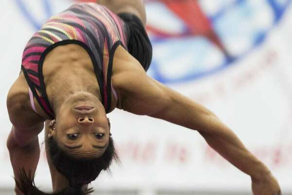 Fresh from picking up six medals - four gold - at the world championships in Doha, Qatar, gymnast Simone Biles is back in Spring working on her balance beam routine Friday at the World Champions Centre.
