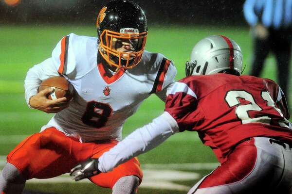 Ridgefield's Jackson Mitchell is defended by Fairfield Warde's Chris Idieu on Friday.