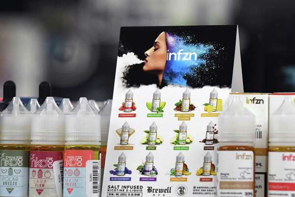 Flavored e-liquids are displayed at Exscape Smoke Shop on Friday, Nov. 9, 2018, on Western Ave. in Albany, N.Y. New York's Department of Health has rescinded proposed regulations seeking to ban flavored e-cigarettes and e-liquids, after industry insiders raised concerns over the legality of such an action. (Will Waldron/Times Union)