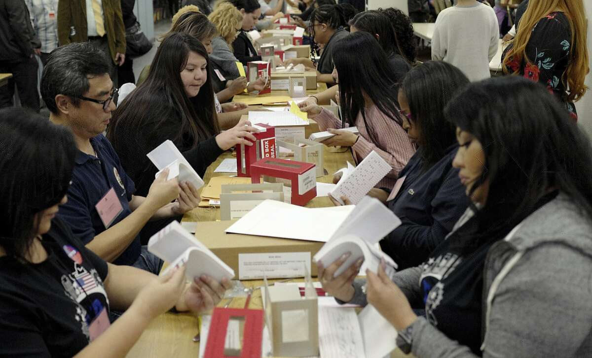 Ballots are sorted and counted during election night at the Los Angeles County Registrar on Tuesday, Nov. 6, 2018 in Norwalk, Calif. (Keith Birmingham/The Orange County Register via AP)