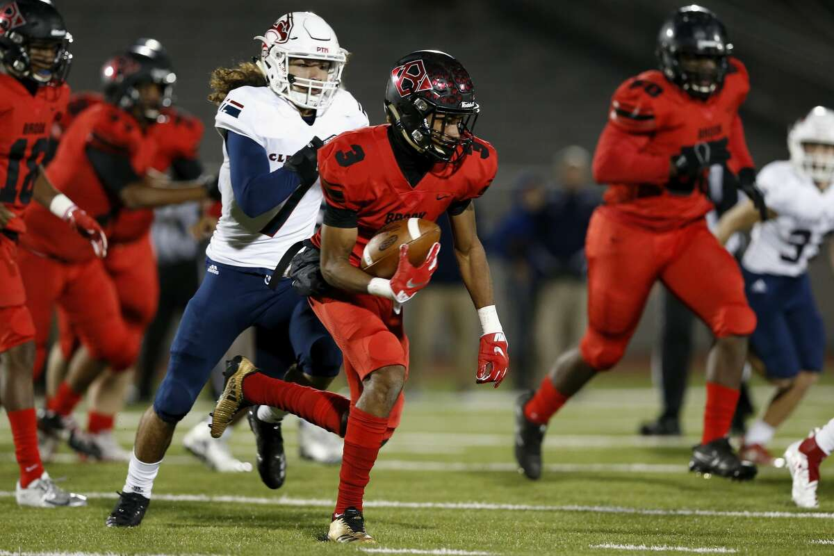 Clear Brook Wolverines Loronzo Thompson (3) runs the ball pursued by Clear Lake Falcons Adrian Cavazos (7) during the high school football game between the Clear Brook Wolverines and the Clear Lake Falcons in Webster, TX on Friday, November 9, 2018.