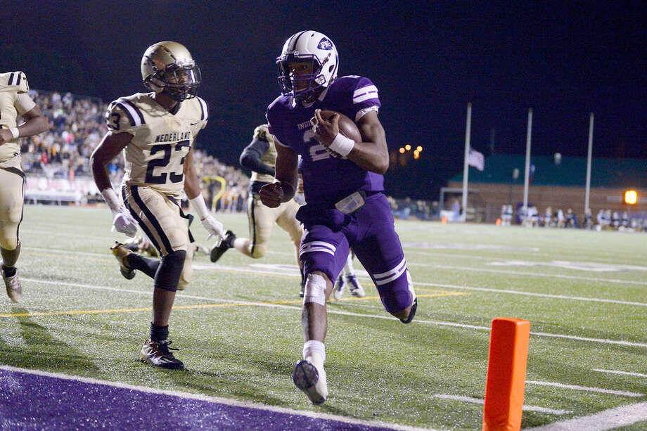 Port Neches-Groves quarterback Roschon Johnson runs in for a touchdown against Nederland in the Mid-County Madness game at Indian Stadium on Friday night. 