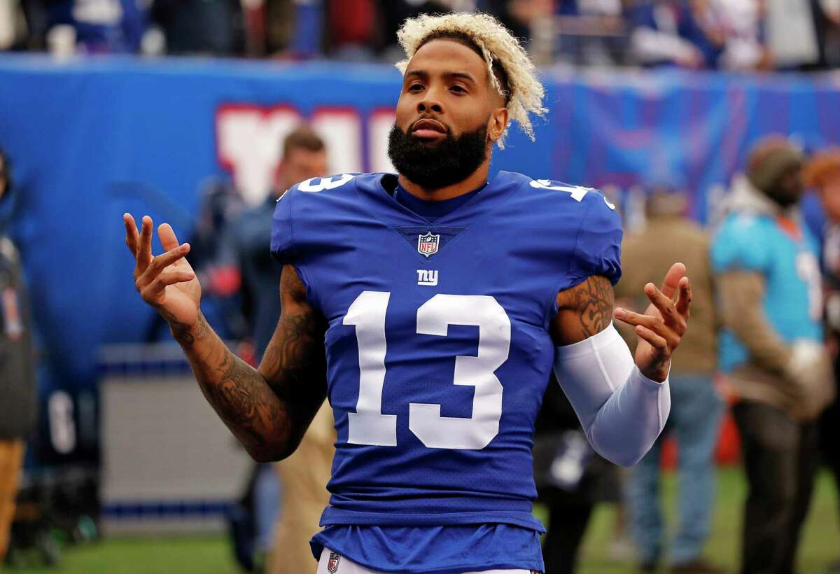 FILE - In this Oct. 28, 2018, file photo, New York Giants wide receiver Odell Beckham (13) gestures before an NFL football game against the Washington Redskins in East Rutherford, N.J. Beckham Jr. is hopeful that his 1-7 team can win the final eight games of the season and somehow sneak into the playoffs. (AP Photo/Adam Hunger, File)
