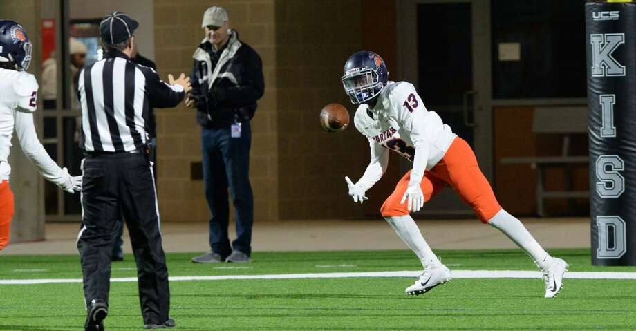 Jaden Embra (13) of Seven Lakes tosses the ball to an official after a touchdown run in the second quarter of a high school football game between the Cinco Ranch Cougars and the Seven Lakes Spartans on Friday, November 9, 2018 at Legacy Stadium, Katy, TX. Photo: Craig Moseley/Staff Photographer