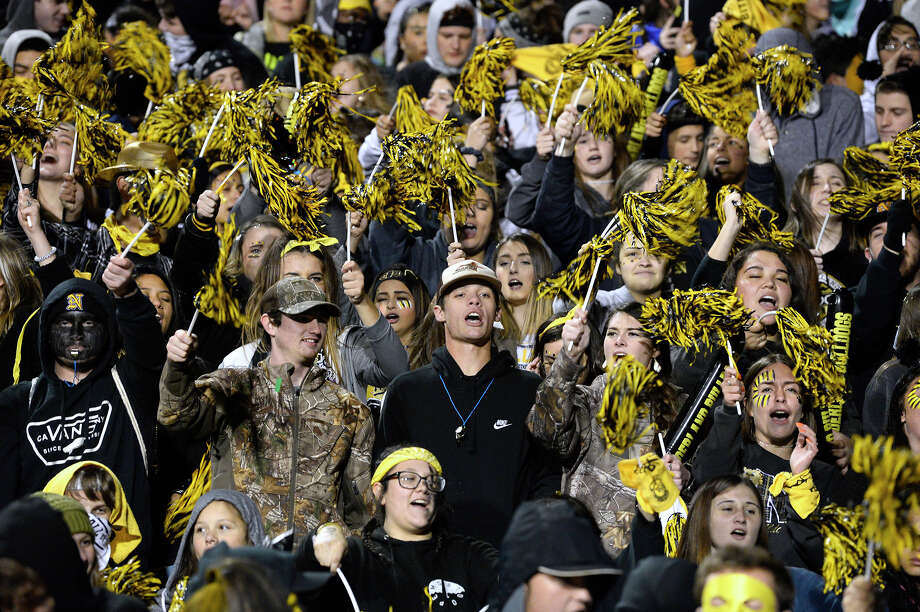 Nederland fans cheer for the Bulldogs before the start of the Mid-County Madness game against Port Neches-Groves at Indian Stadium on Friday night.  Photo taken Friday 11/9/18 Ryan Pelham/The Enterprise Photo: Ryan Pelham/The Enterprise / ©2018 The Beaumont Enterprise