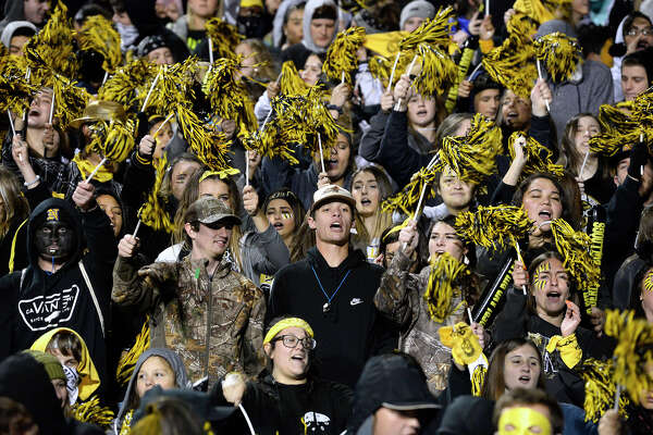 Nederland fans cheer for the Bulldogs before the start of the Mid-County Madness game against Port Neches-Groves at Indian Stadium on Friday night. Photo taken Friday 11/9/18 Ryan Pelham/The Enterprise