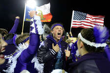 Port Neches-Groves players and fans celebrate winning the Mid-County Madness game against Nederland at Indian Stadium on Friday night. Photo taken Friday 11/9/18 Ryan Pelham/The Enterprise