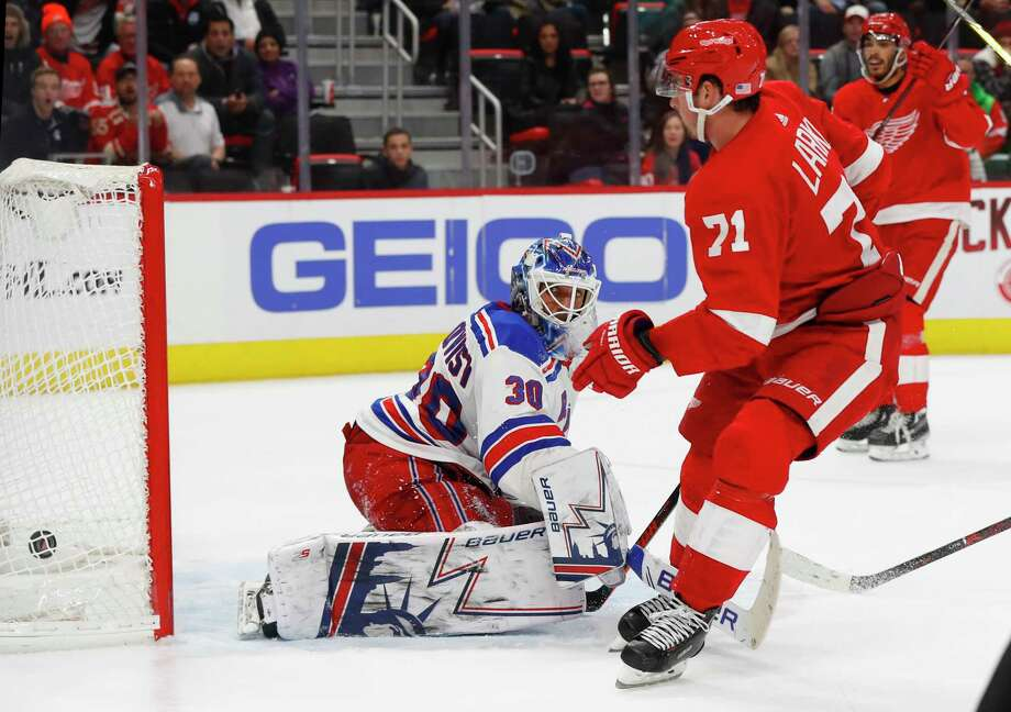Detroit Red Wings' Dylan Larkin scores on New York Rangers goalie Henrik Lundqvist in overtime of an NHL hockey game in Detroit, Friday, Nov. 9, 2018. Detroit won 3-2. (AP Photo/Paul Sancya) Photo: Paul Sancya / Copyright 2018 The Associated Press. All rights reserved.