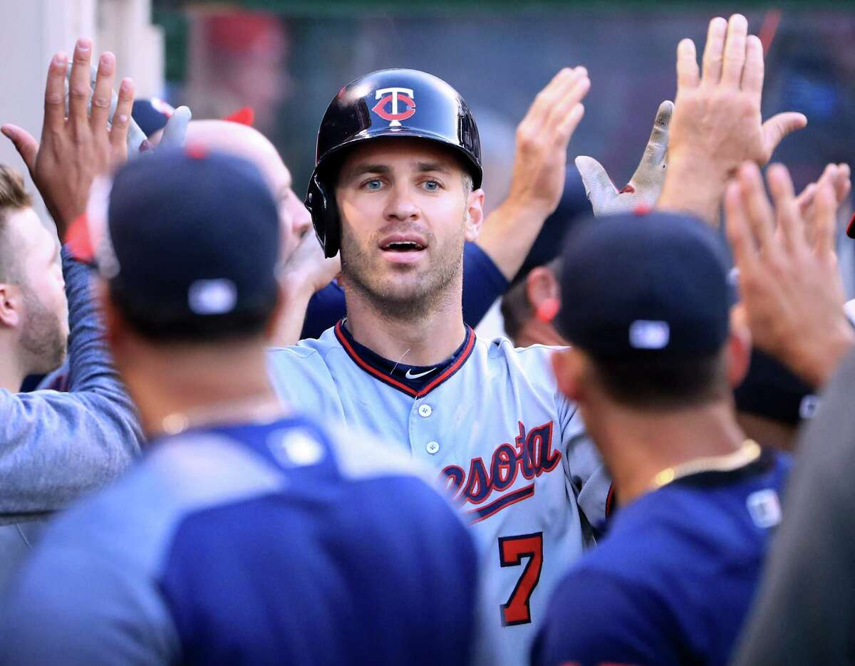 ANAHEIM, CA - JUNE 02: Joe Mauer #7 of the Minnesota Twins celebrates his two run homerun with his dugout for a 2-0 lead over the Los Angeles Angels during the first inning at Angel Stadium of Anaheim on June 2, 2017 in Anaheim, California. (Photo by Harry How/Getty Images) ORG XMIT: 700011061