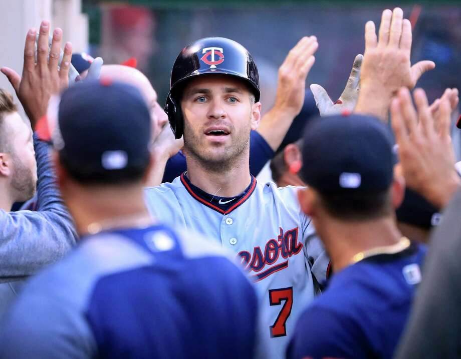 ANAHEIM, CA - JUNE 02:  Joe Mauer #7 of the Minnesota Twins celebrates his two run homerun with his dugout for a 2-0 lead over the Los Angeles Angels during the first inning at Angel Stadium of Anaheim on June 2, 2017 in Anaheim, California.  (Photo by Harry How/Getty Images) ORG XMIT: 700011061 Photo: Harry How / 2017 Getty Images