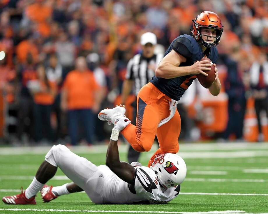 Syracuse quarterback Eric Dungey, top, tries to break the grasp of Louisville defensive end Tabarius Peterson during the first half of an NCAA college football game in Syracuse, N.Y., Friday, Nov. 9, 2018. (AP Photo/Adrian Kraus) Photo: Adrian Kraus / Copyright 2018 The Associated Press. All rights reserved.