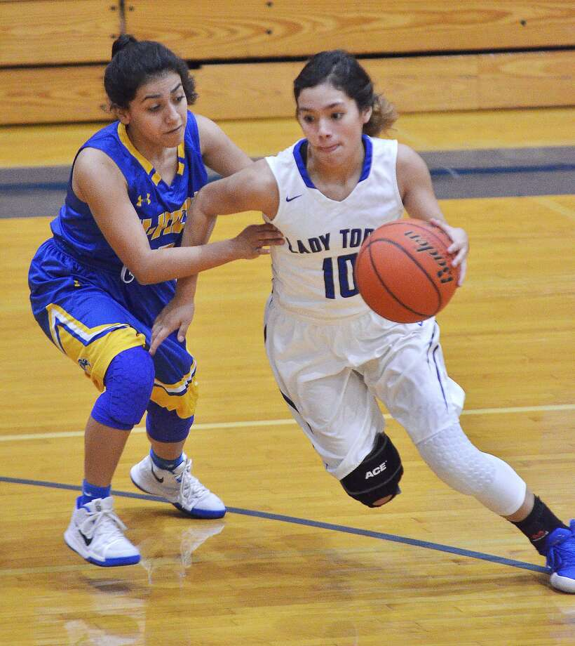Larizza Cantu and Cigarroa went 2-0 during Day 2 of a tournament in La Joya. Cantu scored 15 points in each of the Lady Toros' games. Photo: Cuate Santos /Laredo Morning Times File / Laredo Morning Times
