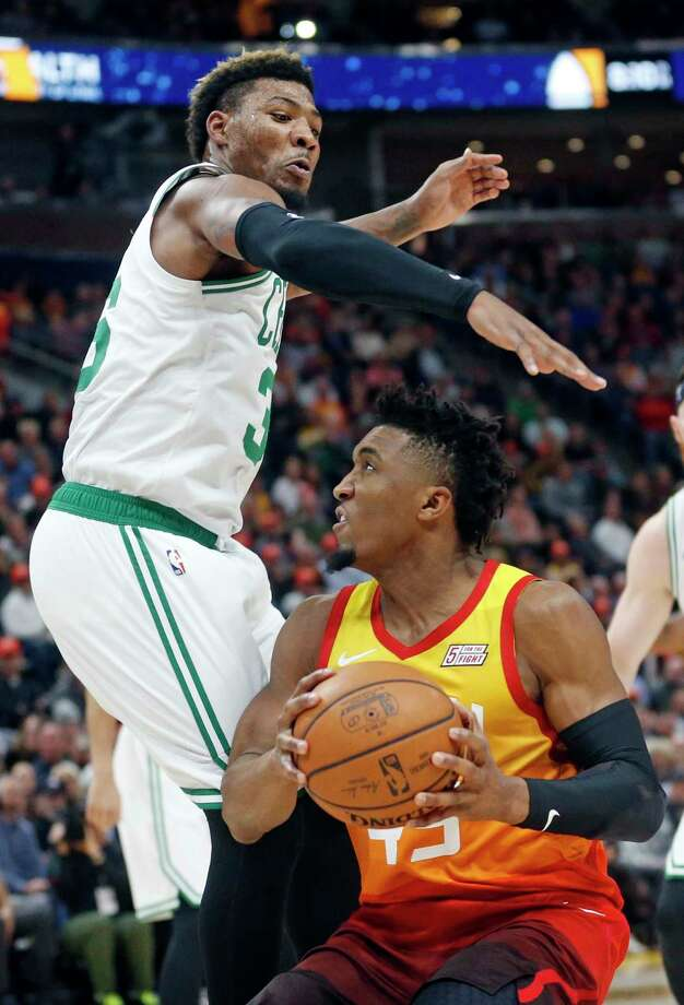 Boston Celtics guard Marcus Smart, left, guards Utah Jazz guard Donovan Mitchell, right, in the first half during an NBA basketball game Friday Nov. 9, 2018, in Salt Lake City. (AP Photo/Rick Bowmer) Photo: Rick Bowmer / Copyright 2018 The Associated Press. All rights reserved