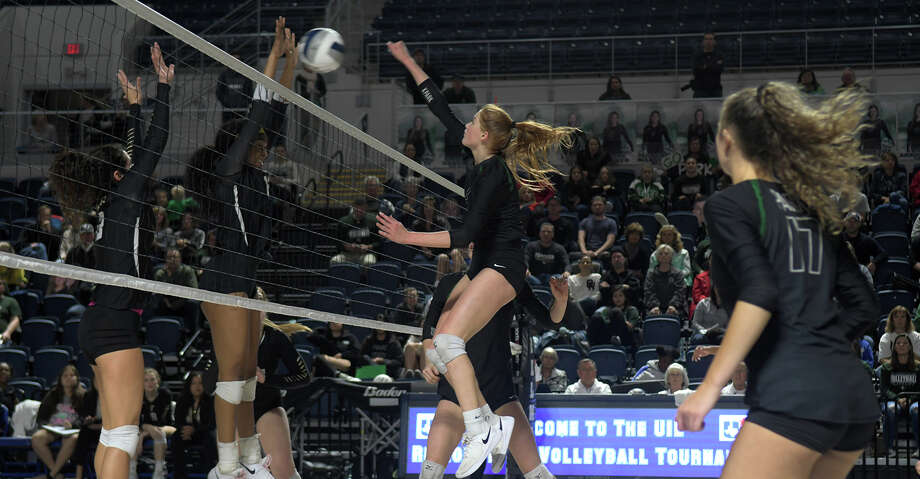Kingwood Park senior middle blocker Katey Searcy, right, makes a play at the net against a Foster defender during the second set of their 2018 Region III 5A UIL Volleyball Regional Semi-Final matchup at Delmar Fieldhouse in Houston on Nov. 9, 2018. Photo: Jerry Baker/Contributor
