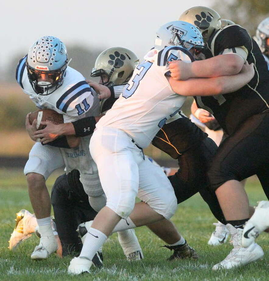 Triopia's Adam Kleinschmidt (right) holds the line in a game against Camp Point Central in September.