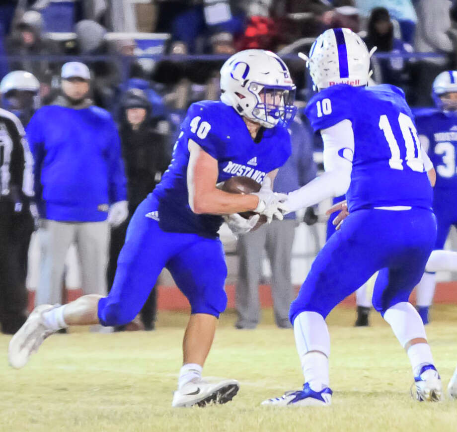 Olton sophomore quarterback Jack Allcorn hands the ball off to senior running back Zane Gunter, who had five touchdowns in Olton's 55-32 win over Hale Center in the District 2-2A finale on Friday night in Olton. Photo: Courtesy Of Albert Gomez / Albert Gomez Photography