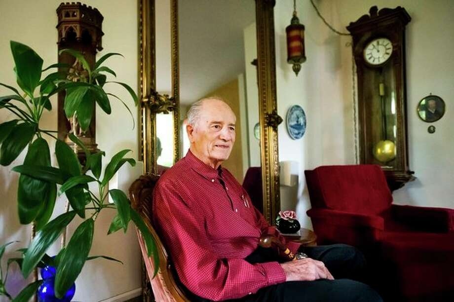 Oswald Anders poses for a portrait inside his home recently in Midland. (Katy Kildee/kkildee@mdn.net)
