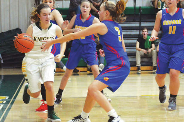 Metro-East Lutheran's Sami Kasting works against two Roxana defenders near the baseline during a regular season home game last year.