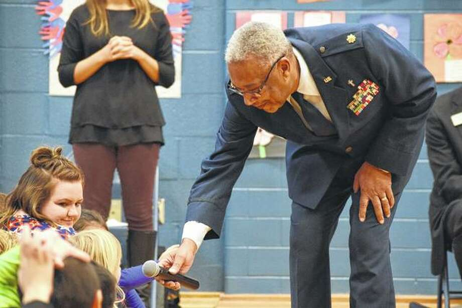 Air Force veteran Louis Eason talks to a South Jacksonville Elementary School student Friday during the school's Veterans' Day event. Photo: Nick Draper | Journal-Courier