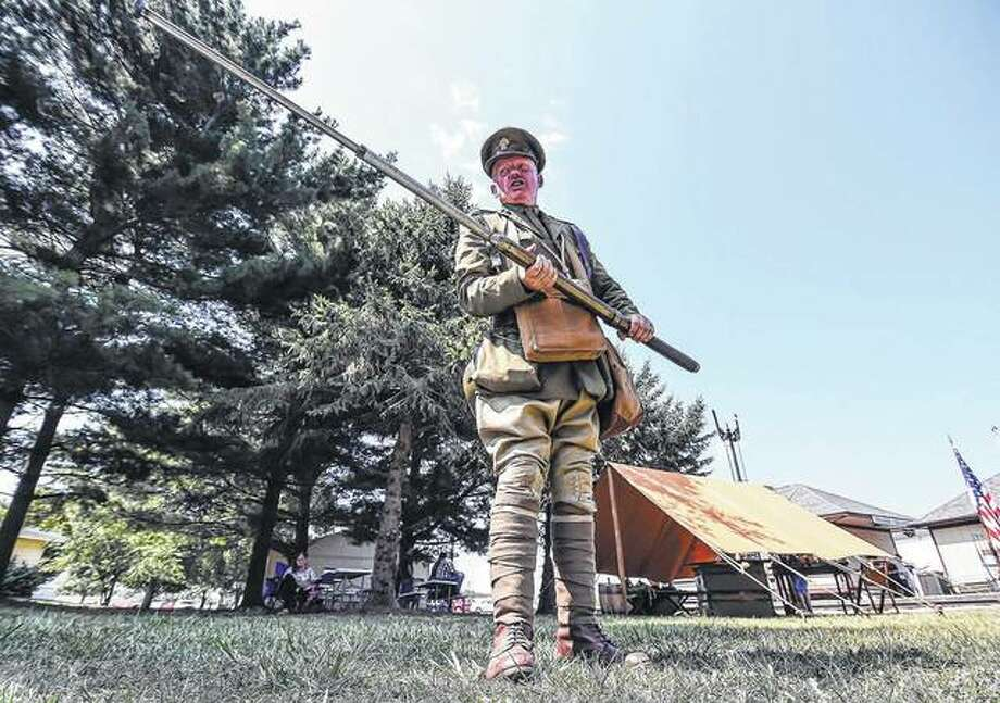 Living history enthusiast Ian Houghton talks about British's side in World War I during an encampment at the Monticello Railway Museum. Photo: Clay Jackson | Herald & Review