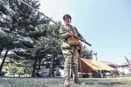 Living history enthusiast Ian Houghton talks about British's side in World War I during an encampment at the Monticello Railway Museum.