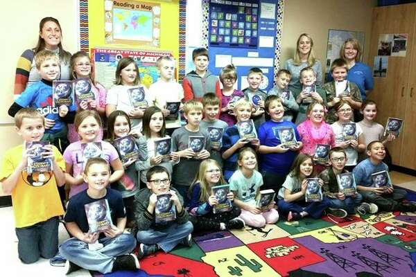 Third grade students from Harbor Beach Schools, Our Lady of Lake Huron and Zion Lutheran Schools received dictionaries through the Rotary Dictionary Project. (Submitted Photo)