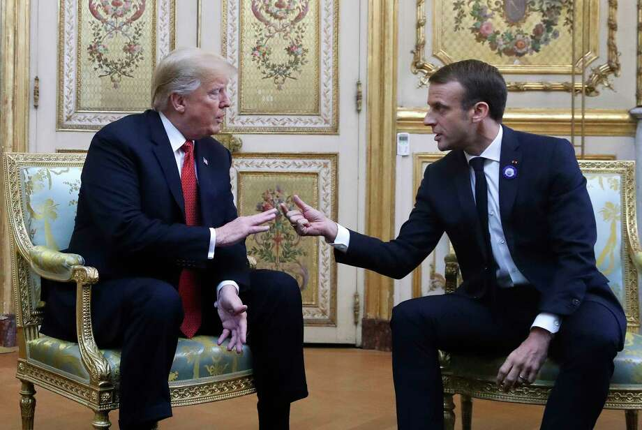 President Donald Trump and French President Emmanuel Macron gesture during their meeting inside the Elysee Palace in Paris Saturday Nov. 10, 2018. Trump is joining other world leaders at centennial commemorations in Paris this weekend to mark the end of World War I. Photo: Jacquelyn Martin, AP / Copyright 2018 The Associated Press. All rights reserved.