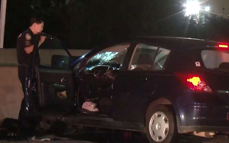 Officials are investigating whether a man was drunk when he crashed his car into a concrete barricade on U.S. 290 about 3 a.m. Saturday, killing a female passenger who officers said was not wearing a seat belt. Photo: Metro Video