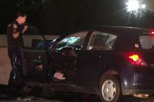 Officials are investigating whether a man was drunk when he crashed his car into a concrete barricade on U.S. 290 about 3 a.m. Saturday, killing a female passenger who officers said was not wearing a seat belt.