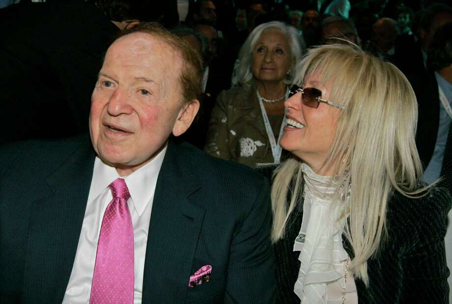 FILE - In this May 13, 2008 file photo, Sheldon Adelson, CEO of the Las Vegas Sands Corp., left, sits with his wife Dr. Miriam Adelson before a session at the President's Conference in Jerusalem. President Donald Trump has announced his first recipients of the Presidential Medal of Freedom and they include  Miriam Adelson, Utah Sen. Orrin Hatch, who is retiring after more than 41 years in the U.S. Senate; former Dallas Cowboys quarterback Roger Staubach and Alan Page, who began a legal career after leaving the NFL. Photo: TARA TODRAS-WHITEHILL, AP / AP2008