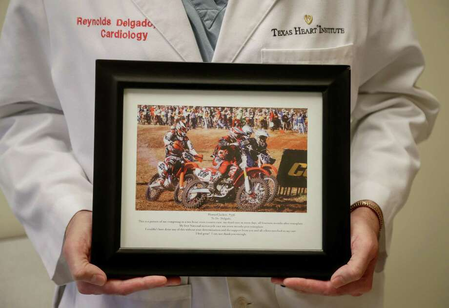 Dr. Reynolds Delgado, a cardiologist who treated Howard Juckett, poses for a portrait with a photo of Juckett in his office, Friday, Nov. 9, 2018, in Houston. Photo: Jon Shapley, Staff Photographer / Staff Photographer / © 2018 Houston Chronicle