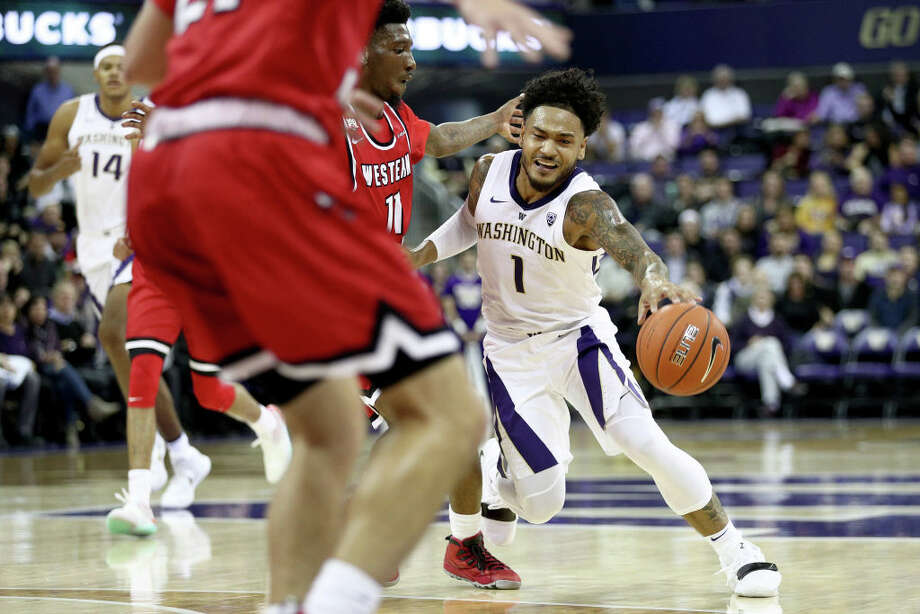 SEATTLE, WA - NOVEMBER 06: David Crisp #1 of the Washington Huskies dribbles against defenders in the first half against the Western Kentucky Hilltoppers during their game at Hec Edmundson Pavilion on November 6, 2018 in Seattle, Washington.  (Photo by Abbie Parr/Getty Images) Photo: Abbie Parr/Getty Images / 2018 Abbie Parr
