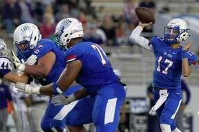 Oak Ridge quarterback Blane Romero, shown here last month against Klein Cain, threw three touchdown passes Friday night against Conroe.