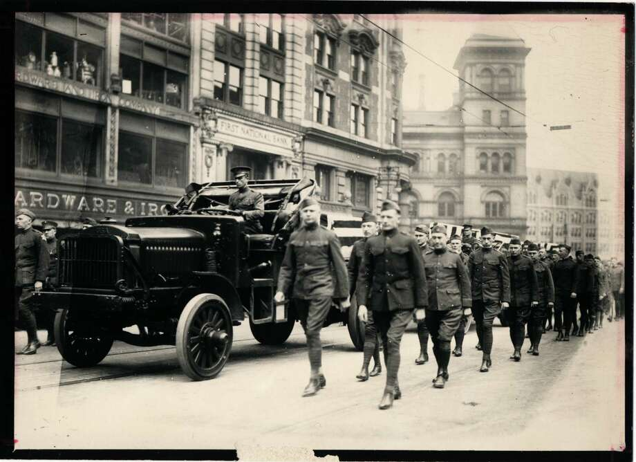 Times Union archive photo:  Local WWI vets march on State Street and Broadway in 1918. Photo: UNKNOWN / TIMES UNION