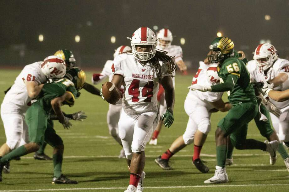 The Woodlands running back Jacoby Clarke (44) finds an opening in the Klein Forest defense to score during a District 15-6A game Thursday, Nov. 8, 2018 at Klein Memorial Stadium. Photo: Cody Bahn, Houston Chronicle / Staff Photographer / © 2018 Houston Chronicle