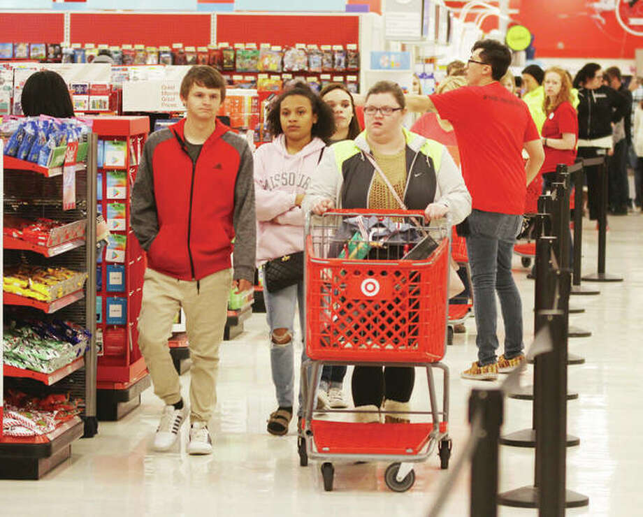 Shoppers head toward the checkout registers at the Alton Target store during holiday shopping last year. Photo: Scott Cousins | The Telegraph
