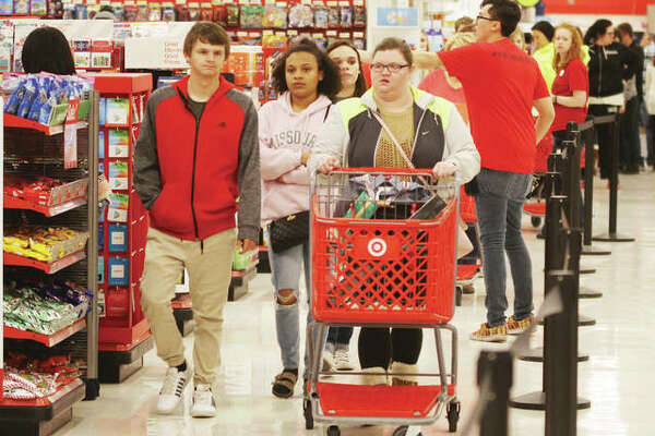 Shoppers head toward the checkout registers at the Alton Target store during holiday shopping last year.