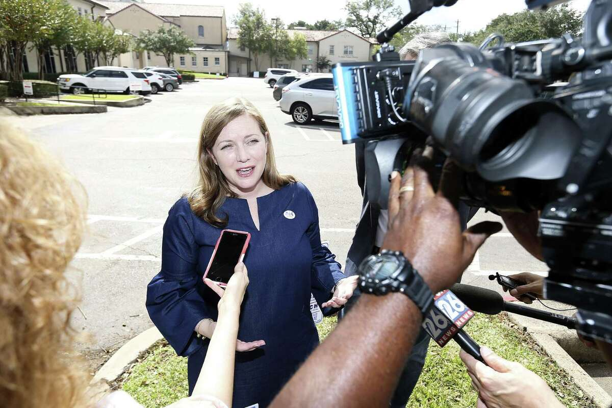 Lizzie Pannill Fletcher talks to the media after voting at St. Anne?'s Catholic Church in Houston on Tuesday, Nov. 6, 2018. Fletcher is running against incumbent John Culberson in U.S. House of Representatives.