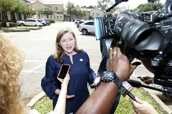 Lizzie Pannill Fletcher talks to the media after voting at St. Annes Catholic Church in Houston on Tuesday, Nov. 6, 2018. Fletcher ran and won her bid for office against incumbent John Culberson in U.S. House of Representatives.