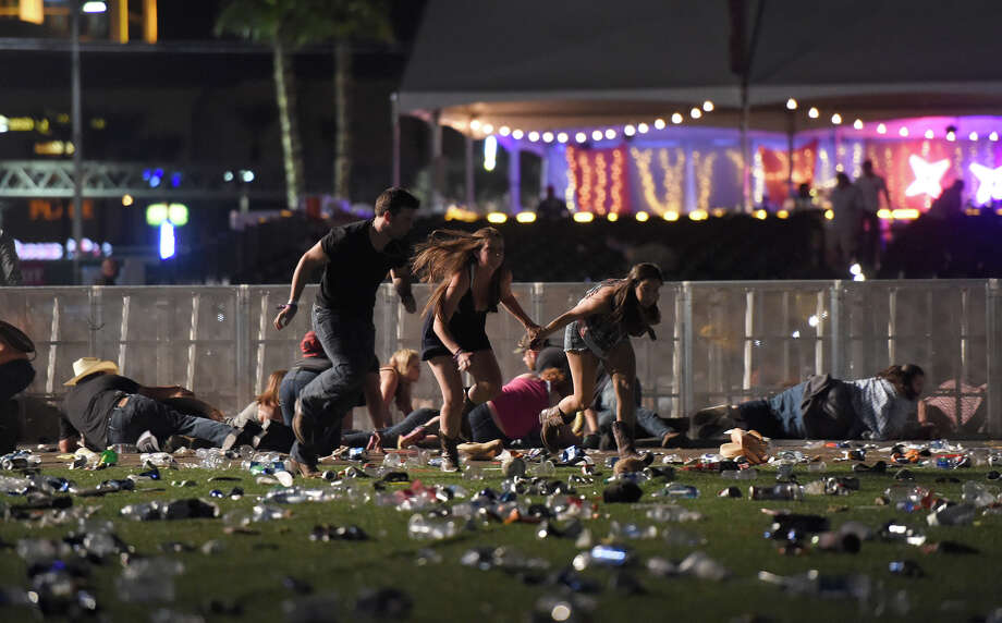 LAS VEGAS, NV - OCTOBER 01  People run from the Route 91 Harvest country music festival after apparent gun fire was heard on October 1, 2017 in Las Vegas, Nevada. There are reports of an active shooter around the Mandalay Bay Resort and Casino.  (Photo by David Becker/Getty Images) ORG XMIT: 775052817 Photo: David Becker / 2017 Getty Images