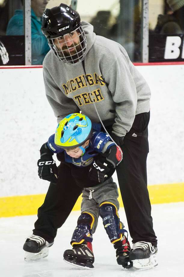 Midland resident Brian Miller helps his son Grant Miller, 3, to learn how to skate during the Try Hockey for Free event on Saturday, Nov. 10, 2018 at Midland Civic Arena. (Katy Kildee/kkildee@mdn.net) Photo: (Katy Kildee/kkildee@mdn.net)